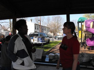 Heart & Soul volunteer Kenya interviews a volunteer at the neighborhood clean up